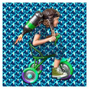 Textilgrafik KOB-Kollage KOB Junge auf Dreirad verschmilzt mit Background